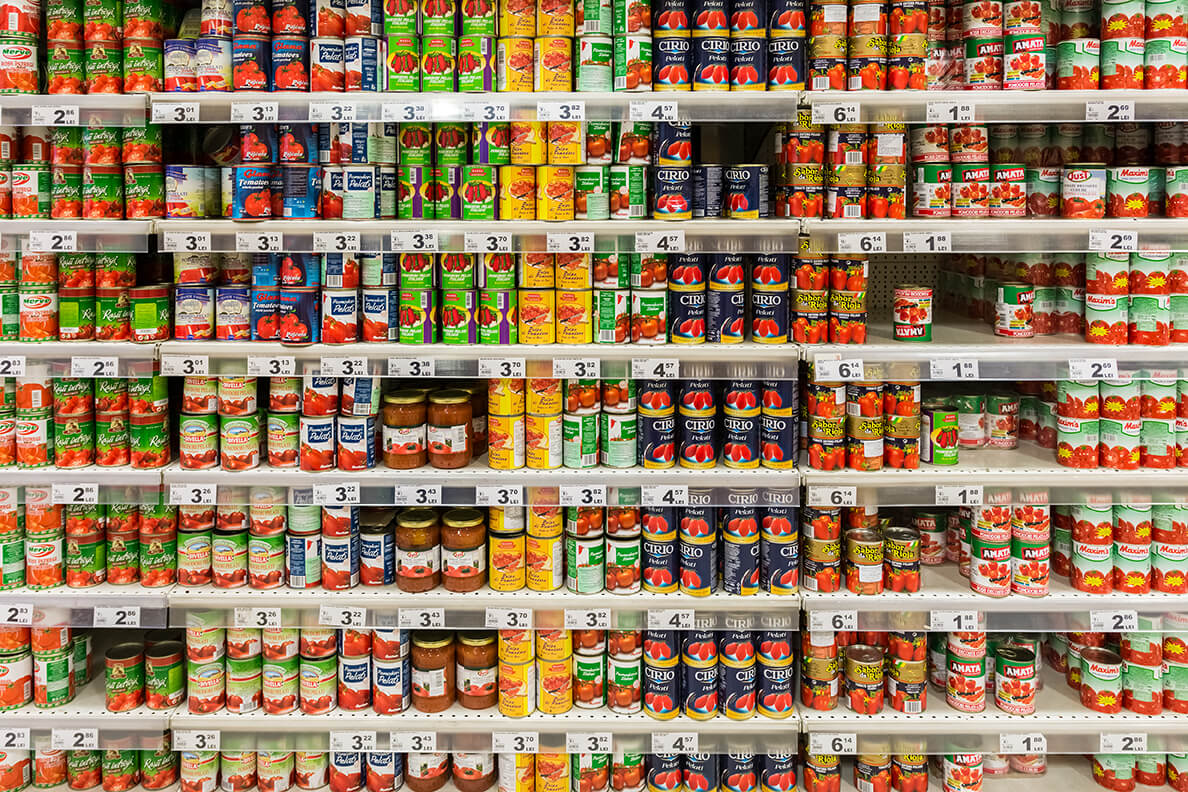 shelf of canned food in a supermarket
